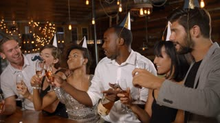 Friends toasting with champagne at New Year�s party in a bar