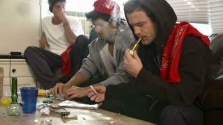 Gang Of Young Men Taking Drugs