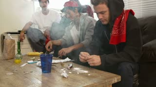 Gang Of Young Men Taking Drugs