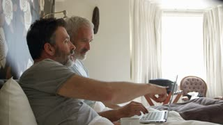 Gay Couple Researching On Laptop In Hotel Room Shot On R3D