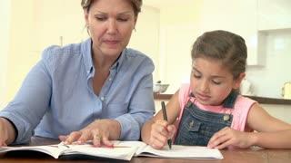 Grandmother Helping Granddaughter With Homework