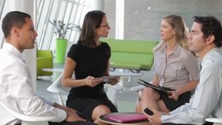 Group Of Business People Having Informal Meeting