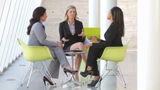 Group Of Businesswomen Having Informal Meeting
