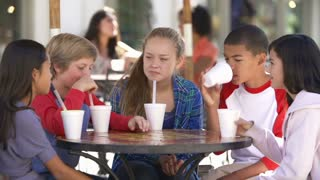 Group Of Children Hanging Out Together In Caf�