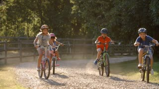 Group Of Children On Cycle Ride In Countryside Together