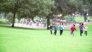 Group Of Children Running Towards Camera In Slow Motion