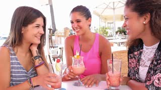 Group Of Female Friends Drinking Cocktails At Outdoor Bar