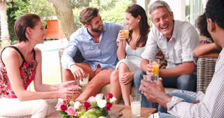 Group Of Friends At Home On Patio Talking Together