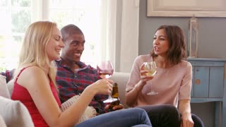 Group Of Friends Drinking Wine At Home Shot On R3D