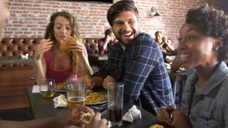 Group Of Friends Eating Out In Sports Bar Shot On R3D