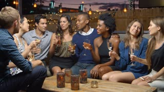 Group Of Friends Enjoy Night Out At Rooftop Bar, Slow Motion