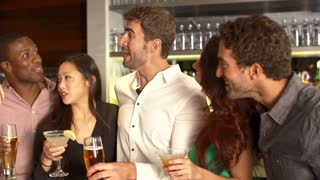 Group Of Friends Enjoying Drink In Bar