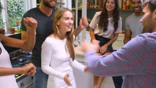 Group Of Friends Enjoying Party And Dancing At Home