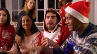 Group Of Friends Having Fun At Christmas Party Together