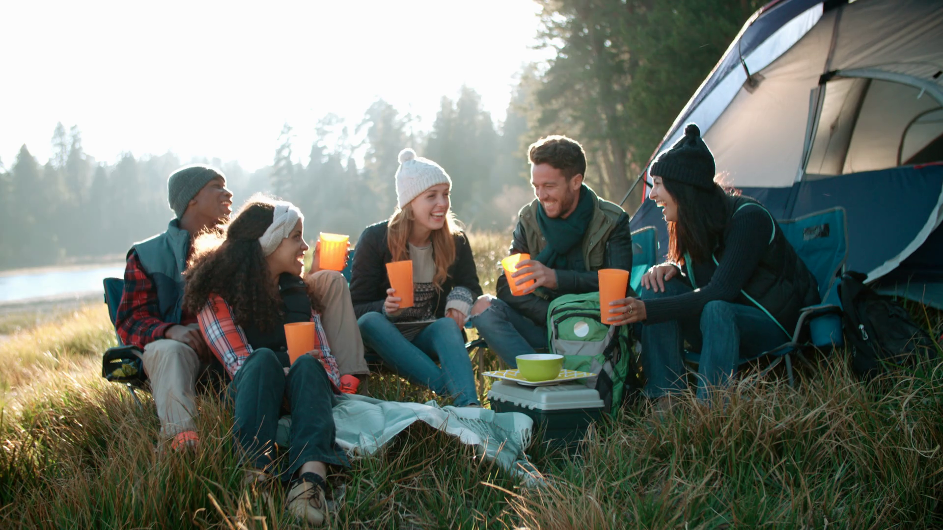 Group of friends on a camping trip sitting outside a tent Stock Video  Footage - Storyblocks
