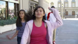 Group Of Teenage Children Posing For Camera In Slow Motion