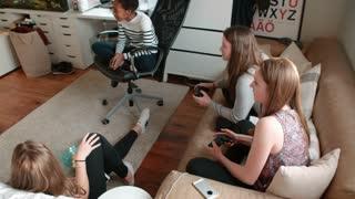 Group Of Teenage Girls Playing Video Game In Bedroom