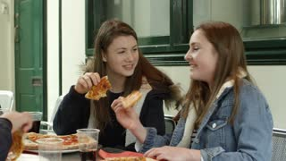 Group Of Teenagers Eating Pizza In Caf� Shot On R3D