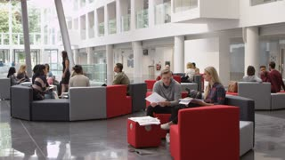 Groups of students working together a university lobby, shot on R3D