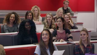 Happy students in the audience at a university lecture, shot on R3D
