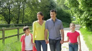 Hispanic Family Walking In Countryside