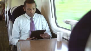 Interior Of Busy Commuter Train With Businesspeople