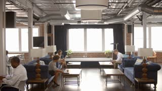 Interior Of Busy Modern Office With Staff Working