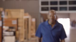 Male Factory Worker Walks Towards Camera In Slow Motion