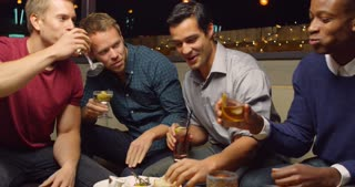 Male Friends Enjoying Night Out At Cocktail Bar Shot On R3D