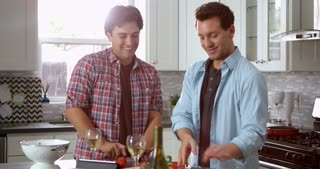 Male gay couple preparing a meal together in the kitchen, shot on R3D