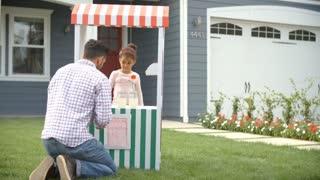 Man Buying Lemonade From Children's Stall Shot On R3D