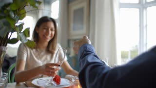 Man Opening Bottle Of Champagne At Valentines Day Meal