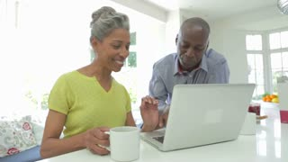 Mature African American Couple Using Laptop At Home