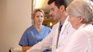 Medical Team Meet At Nurses Station In Hospital Shot On R3D