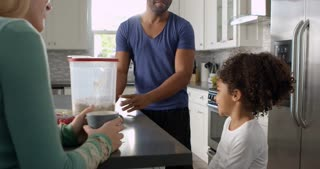 Mixed race couple and daughter talk in the kitchen, close up, shot on R3D