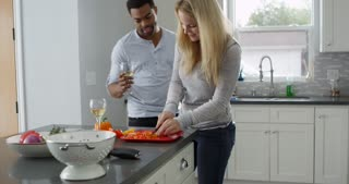 Mixed race couple preparing a meal in their kitchen, shot on R3D