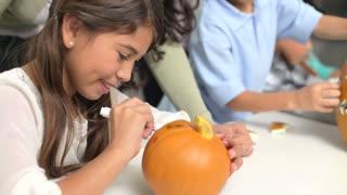 Mothers And Children Making Halloween Lanterns