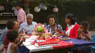 Multi generation black family at table for 4th July barbecue, shot on R3D
