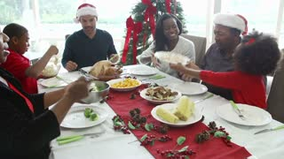 Multi-Generation Family Enjoying Christmas Meal Together