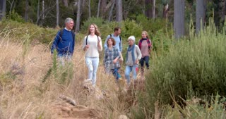 Multi-generation family walking on a country path