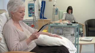 Nurse Checking On Senior Female Patient Having Chemotherapy