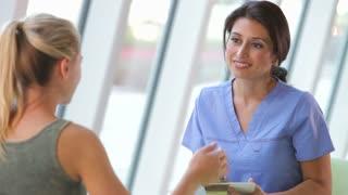 Nurse Taking Notes Froom Teenage Female Patient