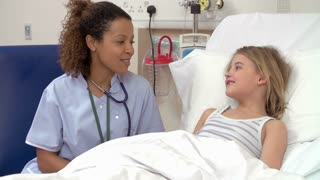 Nurse With Stethoscope Examining Young Girl In Hospital Bed