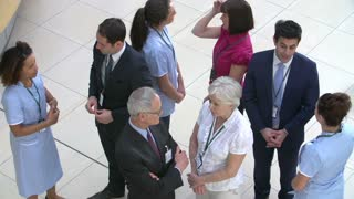Overhead View Of Hospital Staff Meeting In Busy Reception