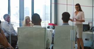 People Attending Business Meeting In Modern Open Plan Office