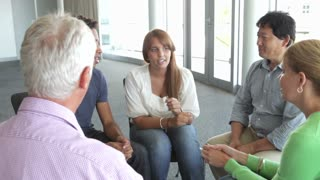 People Having Discussion In Support Group