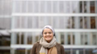 Portrait Of British Muslim Businesswoman Outside Office
