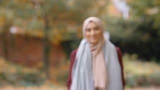 Portrait Of British Muslim Woman In Urban Park