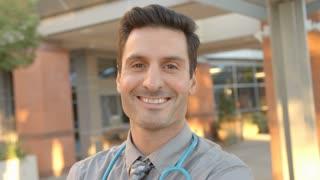 Portrait Of Doctor Standing Outside Hospital Shot On R3D