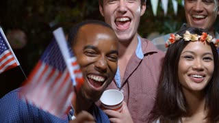Portrait Of Friends Celebrating 4th Of July With Party